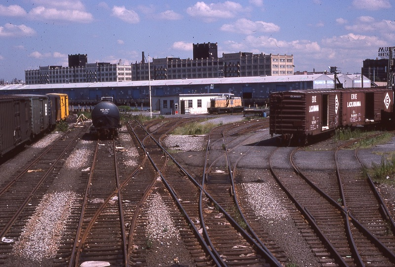 An overview of Atlantic Terminal Yard, looking Northeast.  Locomotive is sitting at the yard office.  8/15/1978<br /><br />